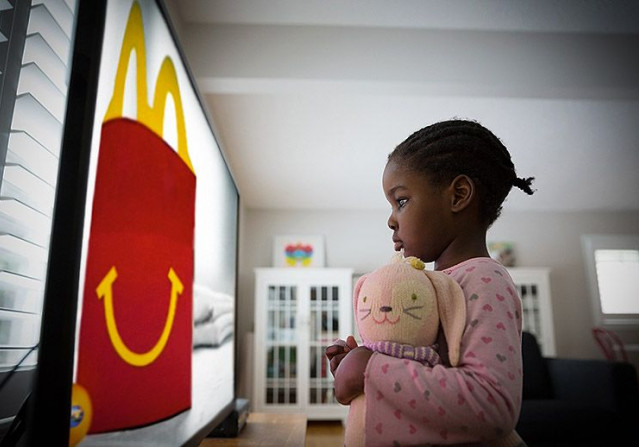 A child views junk food on a screen